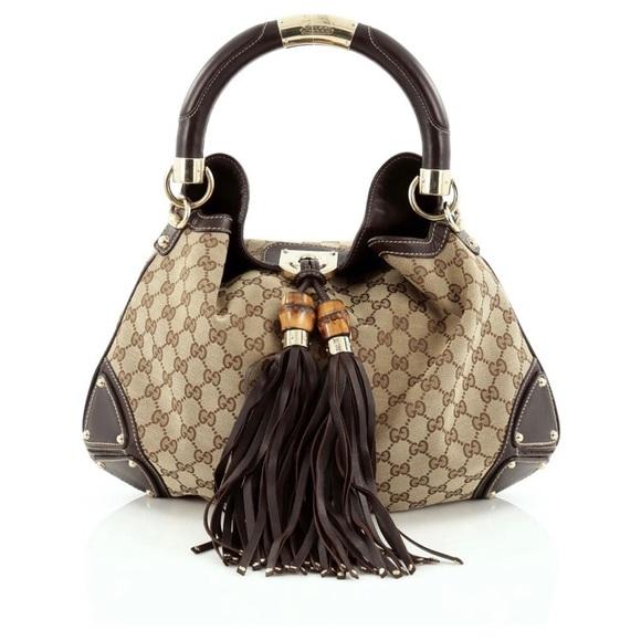 9743353633f Gucci Handbags - Gucci Brown Monogram Indy Tassel Medium Handbag